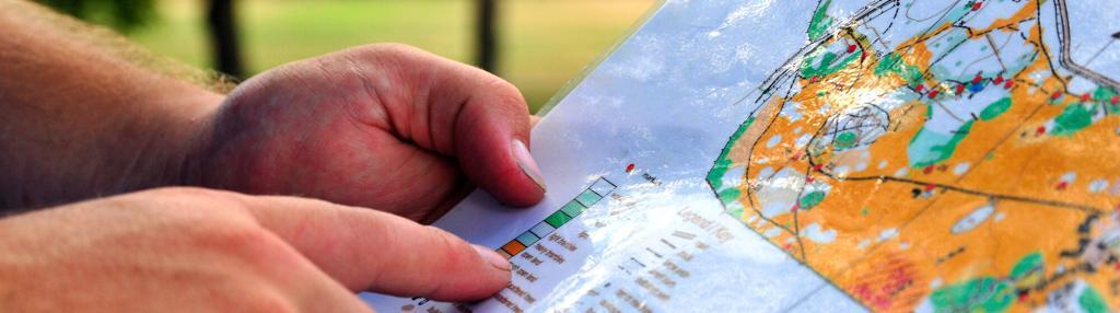 hand holding orienteering map