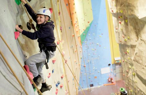 boy climbing at the lock