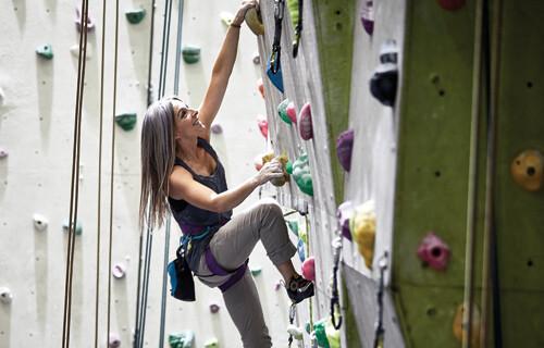 happy experienced female climber
